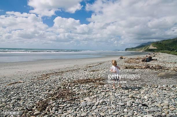 Child on stoney beach