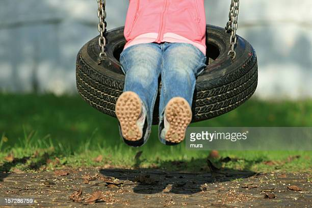 child on the swing - demography stock pictures, royalty-free photos & images
