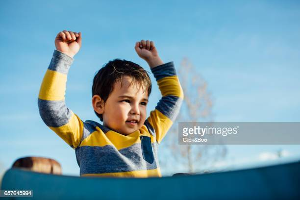 Child on the top of a slide