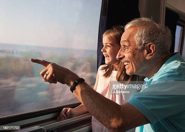 child on train ride with grandpa - passenger train stock pictures, royalty-free photos & images