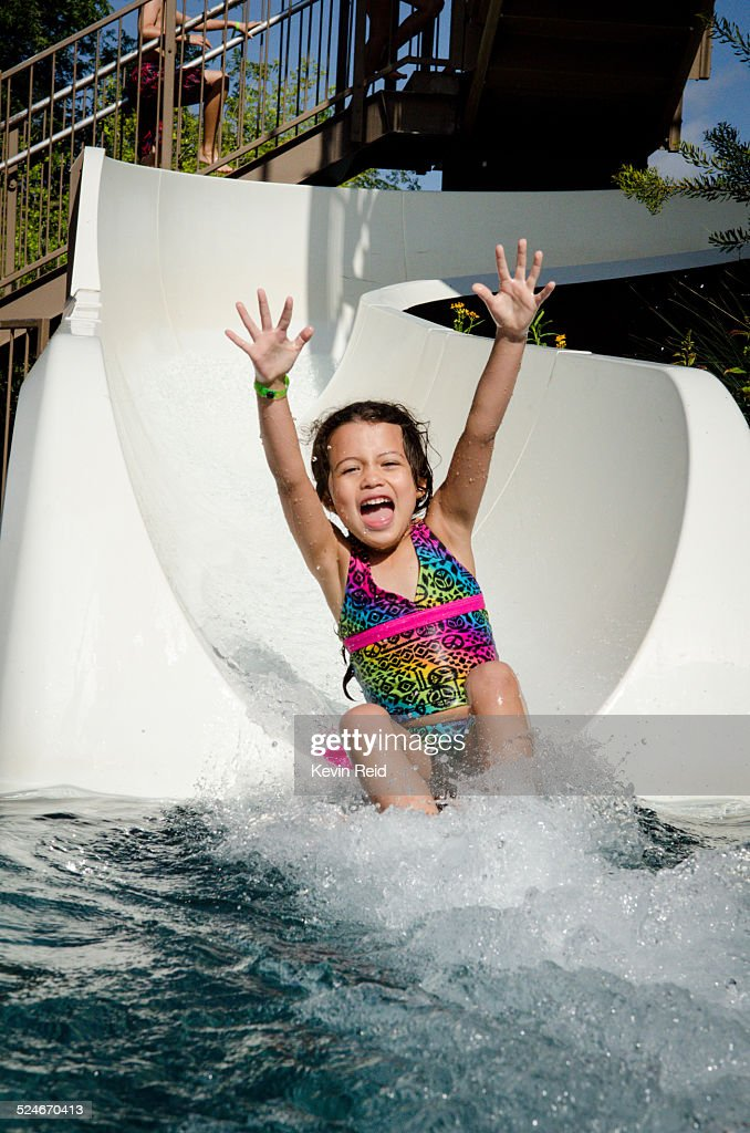 Child on water slide : Stock Photo
