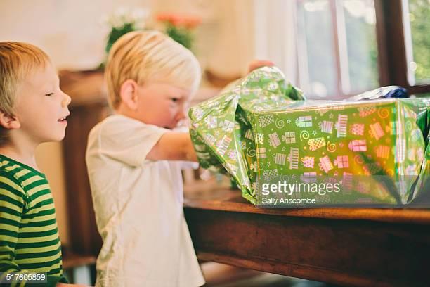 Child opening a birthday present