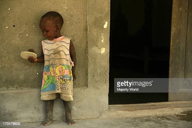 A child outside a derelict house in Ibo Island in Quirimbas archipelago in Mozambique September 21 2006