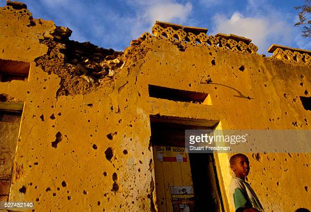 A child outside his house that clearly shows the scars of the battle for Hargeisa the capital of the Self Declared Independent country of Somaliland...