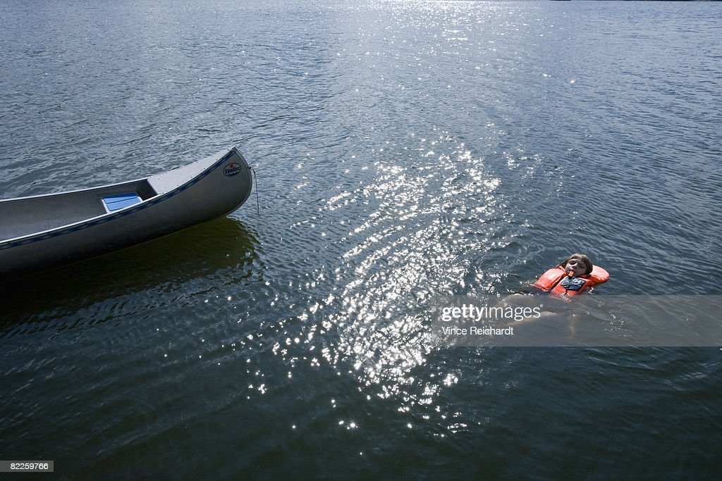 A child overboard and a canoe Sweden. : Stock Photo