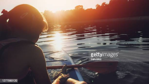 child paddling on a sup board - ivanjekic stock pictures, royalty-free photos & images