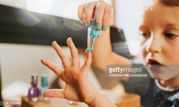 child painting finger nails - human finger stock pictures, royalty-free photos & images