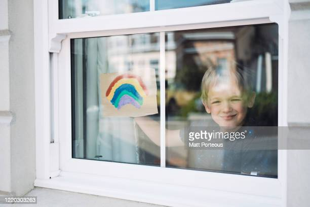 child painting rainbow - nhs stock pictures, royalty-free photos & images