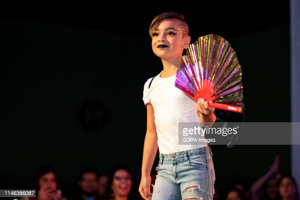 A child participates in a fashion show during RuPaul's DragCon LA 2019 at the Los Angeles Convention Center in Los Angeles California The annual...