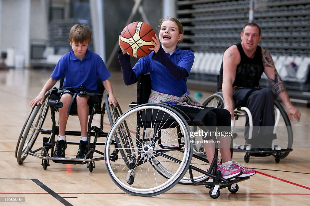 A child participates in a game of wheelchair basketball during the launch of the New Zealand Olympic Ambassador Programme at ASB Sports Centre on June 20, 2013 in Wellington, New Zealand.