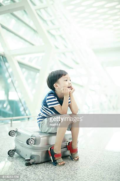 Child passing through the airport terminal