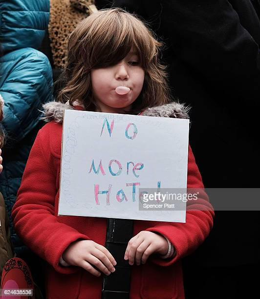 A child pauses during an antihate rally at a Brooklyn park named in memory of Beastie Boys band member Adam Yauch after it was defaced with swastikas...