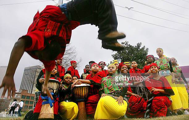 Child performers from the BW Cooper Dance and Drum Troupe an African inspired group pose for a photo during Mardi Gras festivites February 7 2005 in...