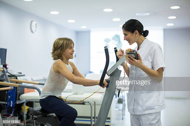 Child performing a stress test with electrodes.