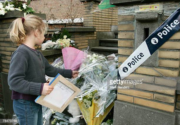 A child places flowers at the entrance of the house of the Mokadem family at the General Jaques Avenue March 2 2007 in Nivelles Belgium The Belgian...