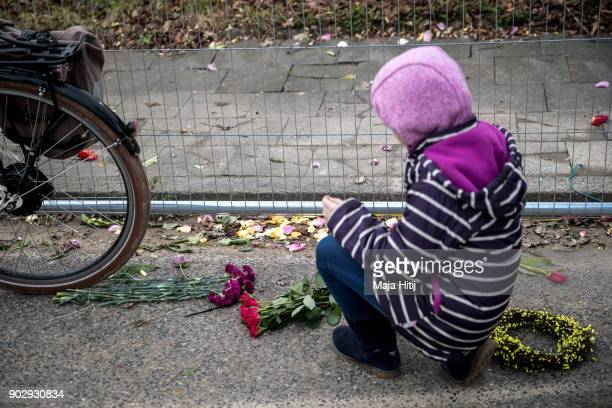 A child places flowers during a demolition of Saint Lambertus church following protests by activists on January 9 2018 in Immerath Germany The...