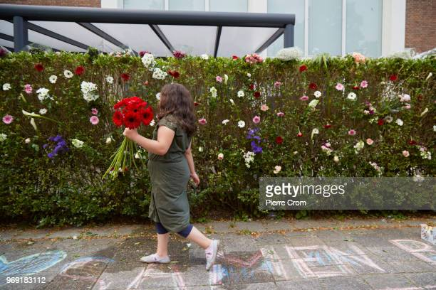 A child places flowers outside the Laleli Mosque on June 7 2018 in Rotterdam NetherlandsThe antiIslam group Pegida plans to roast pigs on a barbecue...