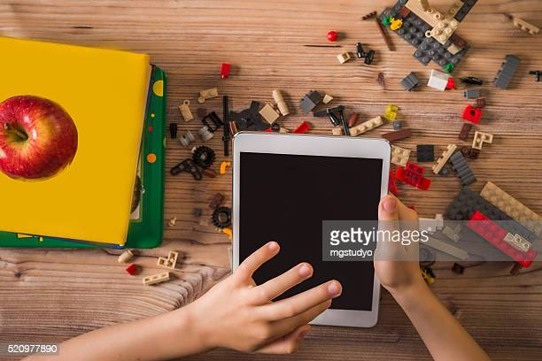 child play digital tablet at school - lego stock pictures, royalty-free photos & images