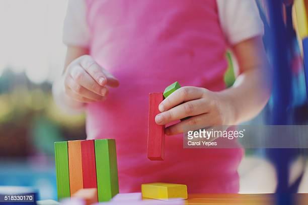 child  playing colorful blocks