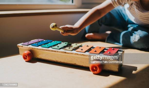 child playing colourful toy xylophone - toy stock pictures, royalty-free photos & images