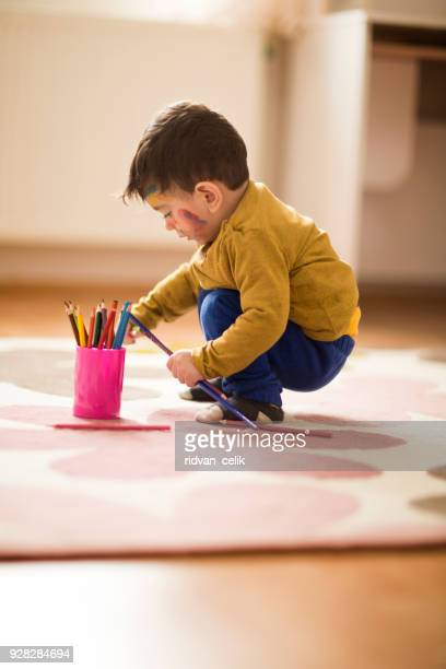 Child playing crayons