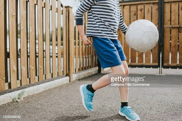 child playing football - soccer competition stock pictures, royalty-free photos & images