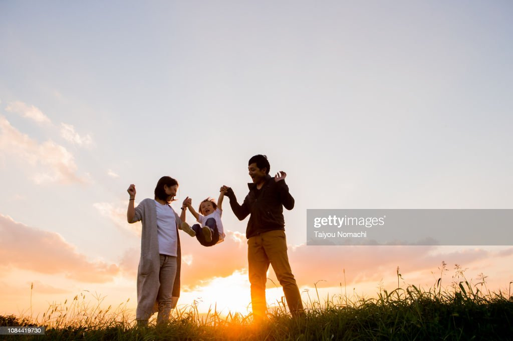 Child playing hands with parents : Stock Photo