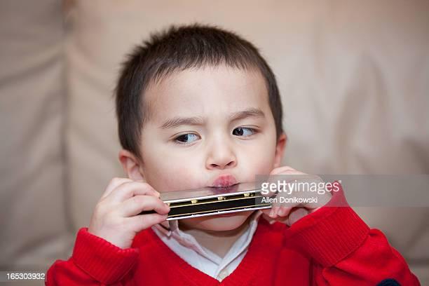 child playing harmonica