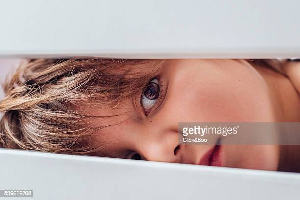 Child playing hide and seek