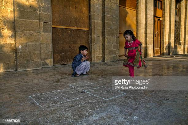 child playing hopscotch - hopscotch stock photos and pictures