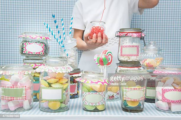 Child playing in a candy store