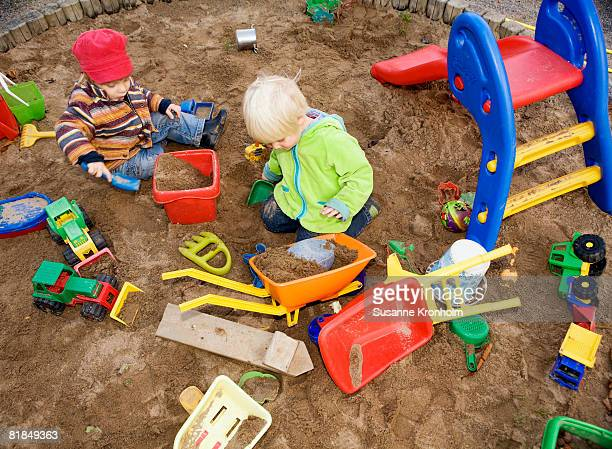A child playing in a sandpit Sweden.