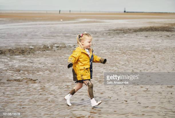 Child playing in the muddy sand