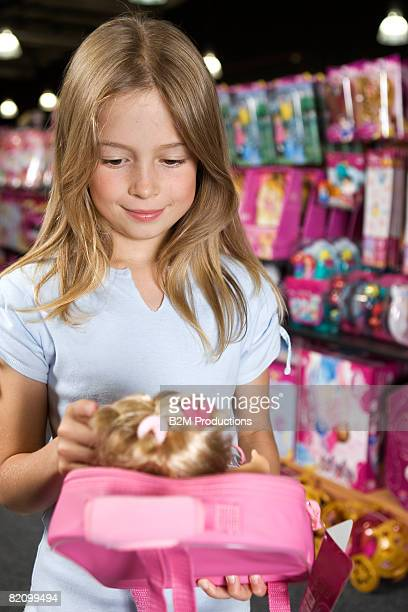 Child (9-10 years) playing in toy store