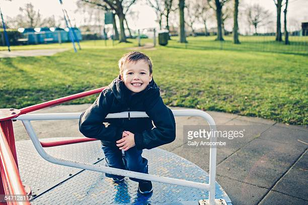 child playing on a roundabout - one boy only stock pictures, royalty-free photos & images