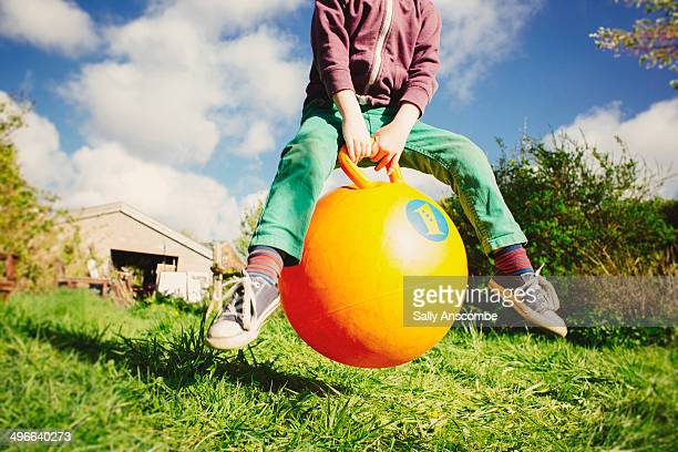 Child playing on a space hopper