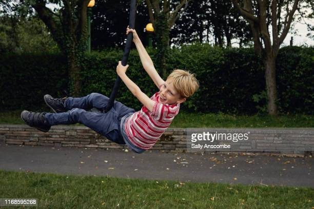 child playing on a zip wire - southport england stock pictures, royalty-free photos & images