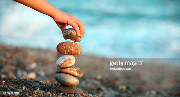 child playing on beach - pebble stock pictures, royalty-free photos & images