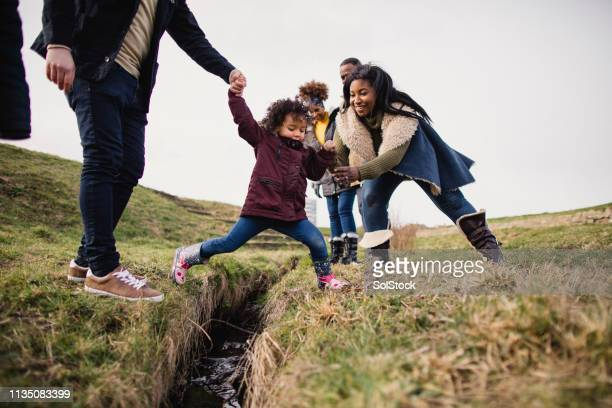 child playing outdoors - outdoors stock pictures, royalty-free photos & images
