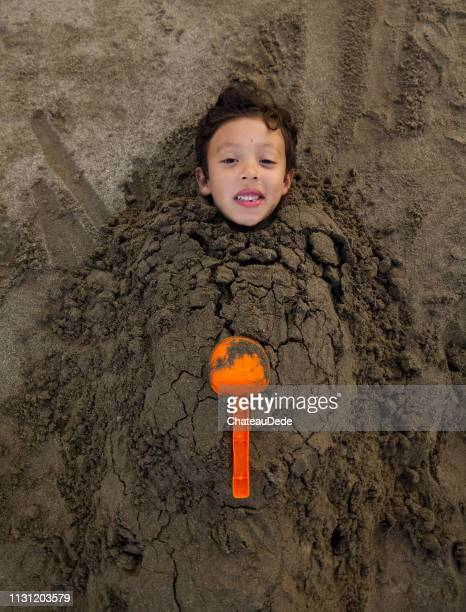child playing - buried stock pictures, royalty-free photos & images