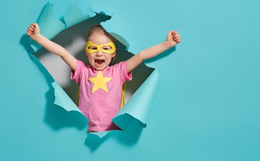child playing superhero 1094375692