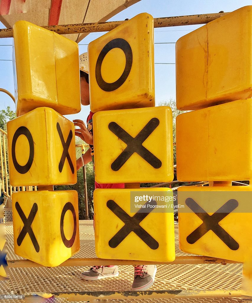 Child Playing Tic-Tac-Toe At Playground : Stock-Foto