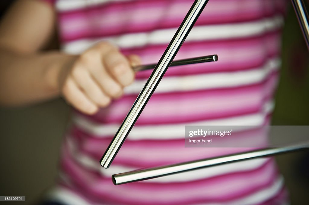Child playing triangle : Stock Photo