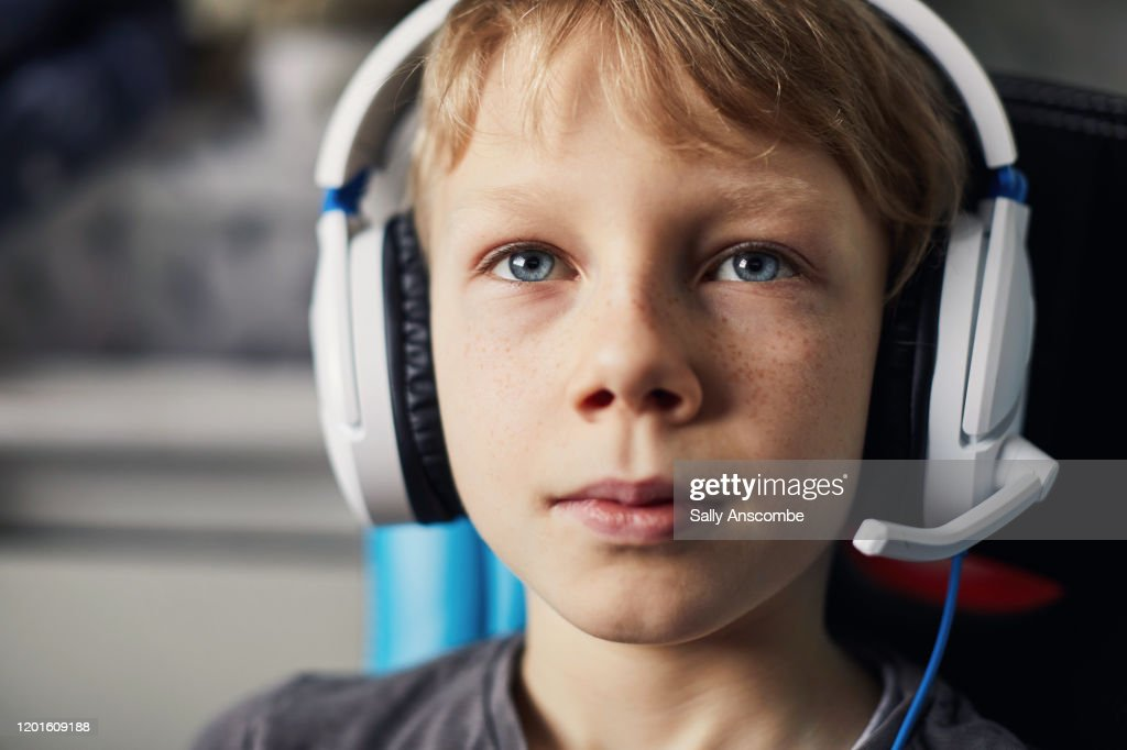 Child playing video games : Stock Photo
