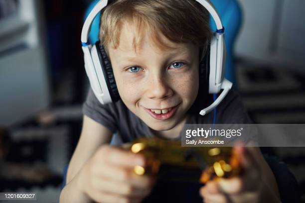 child playing video games - sally anscombe stock pictures, royalty-free photos & images