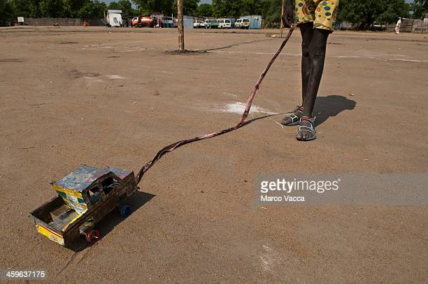 child playing with a selfmade toycar - south sudan stock pictures, royalty-free photos & images