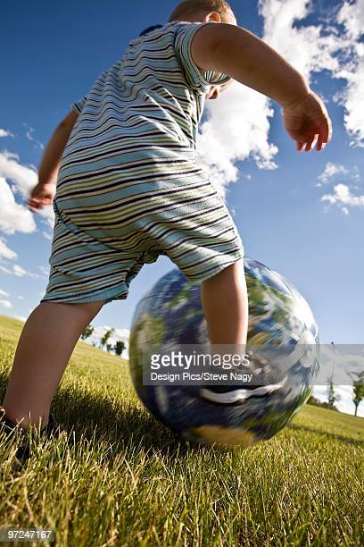 child playing with ball - blue balls pics stock pictures, royalty-free photos & images