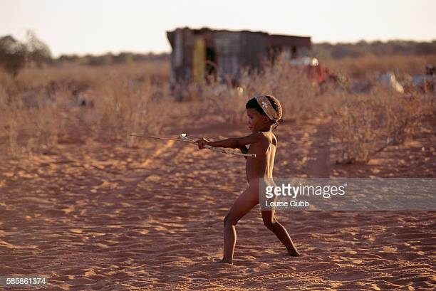 Child Playing with Bow and Arrow in South Africa