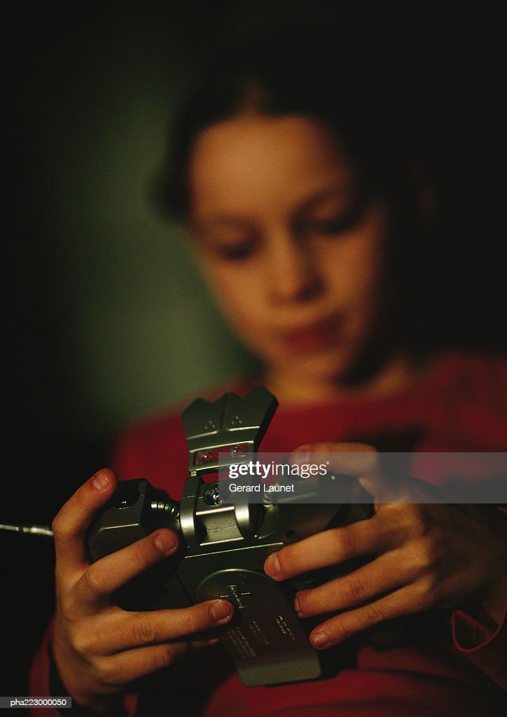 Child playing with camera, blurred, close up. : Stockfoto