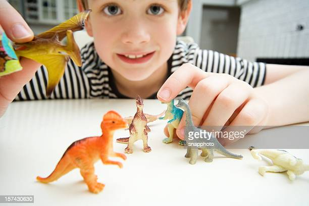 Child Playing with Dinosaurs in Kitchen Lifestyle